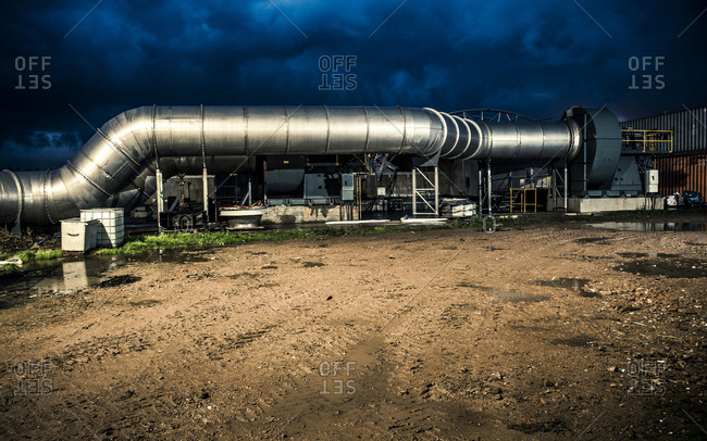Yorkshire, England, UK - October 29, 2012: Industrial piping outside at dusk