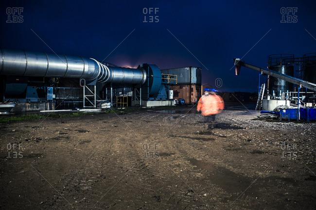 Yorkshire, England, UK - October 29, 2012: Industrial setting in motion blur at dusk