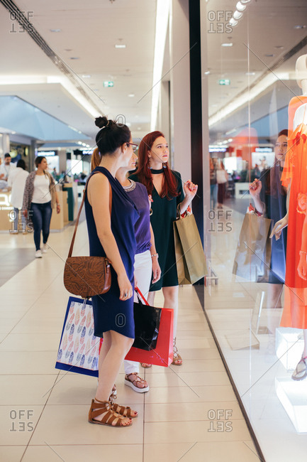 Belgrade, Serbia - June 7, 2017: Young women looking in a store display window in a shopping mall