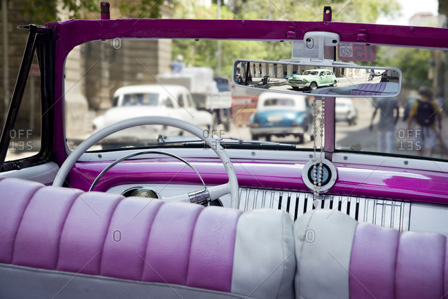 Havana, Cuba - May 23, 2017: Pink interior of a vintage convertible car parked on the street