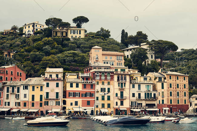 Portofino, Italy - June 3, 2016: Multi-colored buildings on the coast of Portofino, Italy