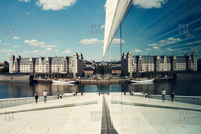 Oslo, Norway - June 14, 2016: Reflection in windows at the Oslo Opera House in Norway