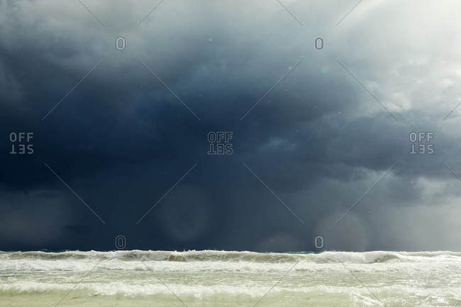 Waves under stormy sky on the coast of Tulum, Quintana Roo, Mexico
