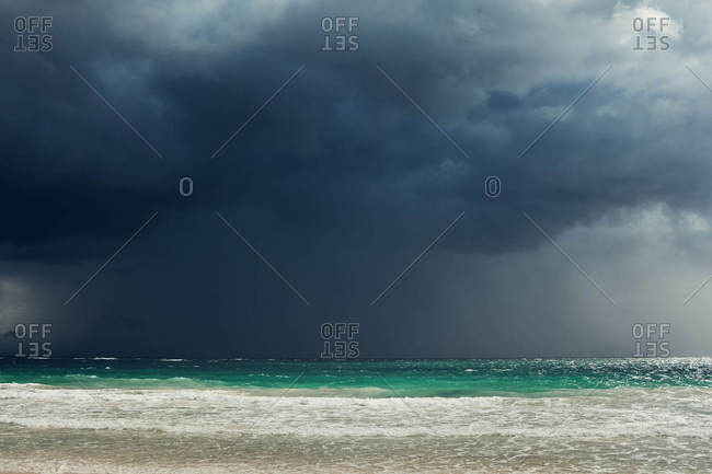 Turquoise water under stormy sky on the coast of Tulum, Quintana Roo, Mexico