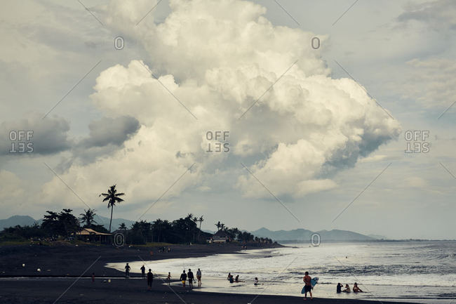 Keramas, Bali, Indonesia - January 12, 2017: Beachgoers on a beach in Bali