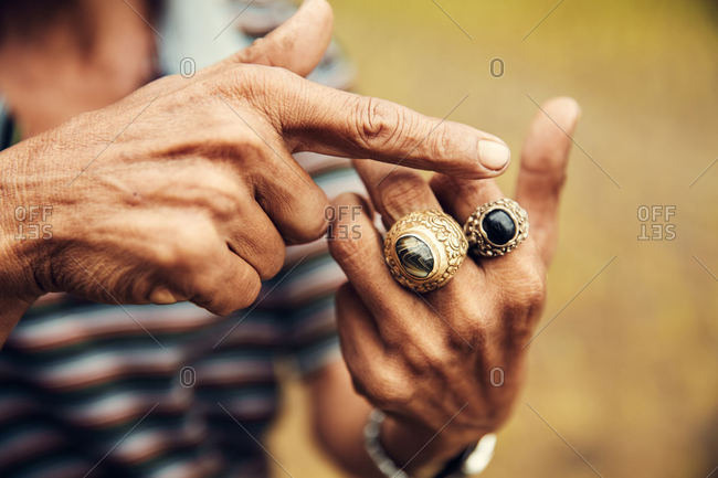 Old hands wearing two rings