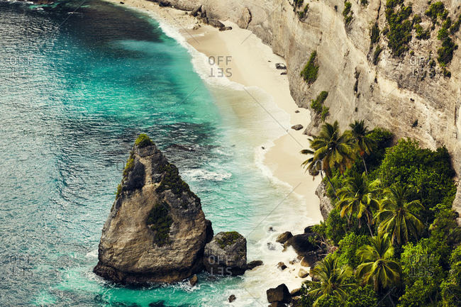 Beach under cliffs in Bali, Indonesia