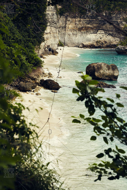 Beach along cliffs in Bali, Indonesia