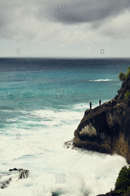 People on cliffs in Bali, Indonesia