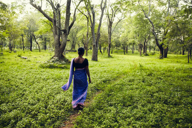 Woman walking through forest in Sri Lanka