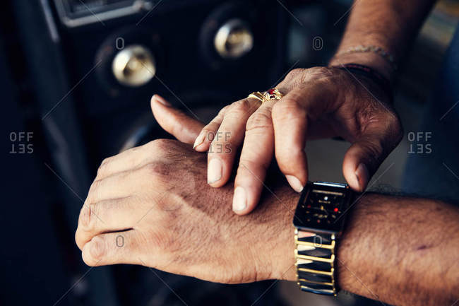 Man touching his wristwatch