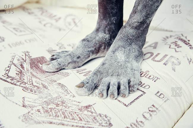 Bare feet on flour sacks