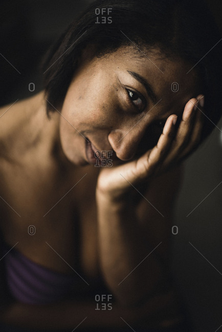 Portrait of a beautiful woman with her hand on her face