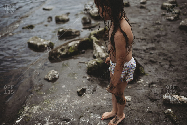 Elevated view of a little girl on beach