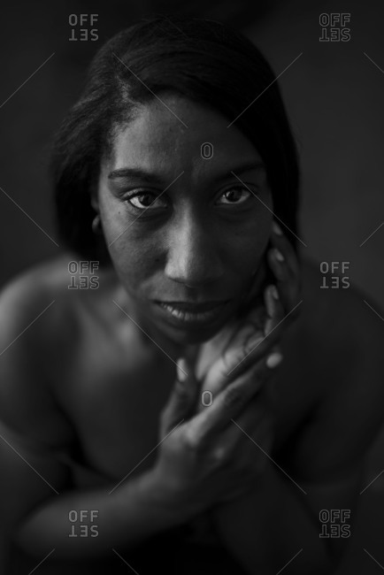 Portrait of a woman with her hand on her face