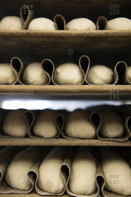 Shelves of bread dough being proofed