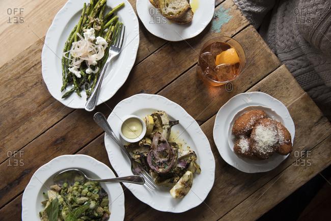 Restaurant table full of vegetable dishes