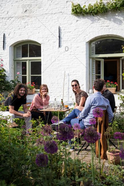 Friends drinking in a garden outdoors