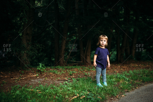 Toddler walking down a rural street