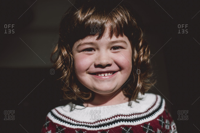Smiling young girl with bangs