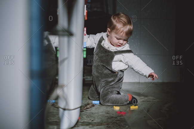 Baby playing with refrigerator magnets