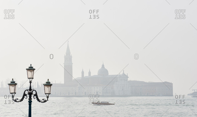 A water taxi in front of the San Giorgio Maggiore island and church in the Venetian Lagoon opposite of San Marco Square in Venice Italy