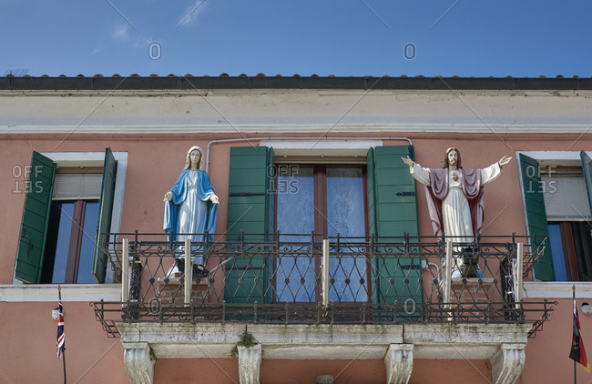 Mary and Jesus statues on a balcony on the Burano island in the Venetian Lagoon in Italy
