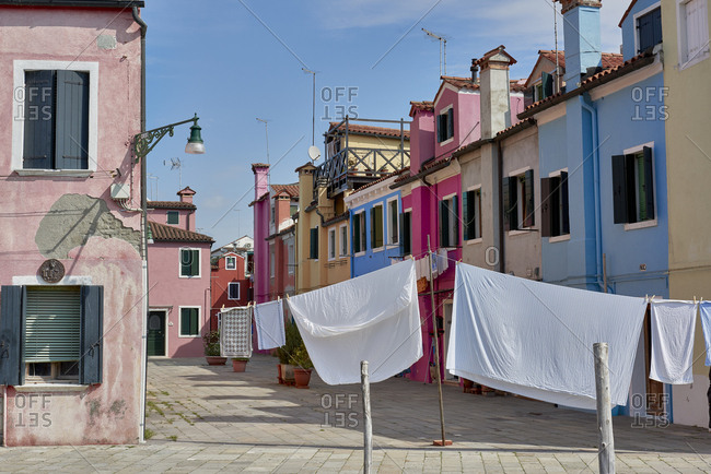 Colorful houses and drying laundry on the Burano island in the Venetian Lagoon in Italy
