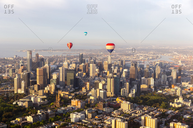 Melbourne, Australia - October 31, 2014: Hot air balloons floating above the city at sunrise