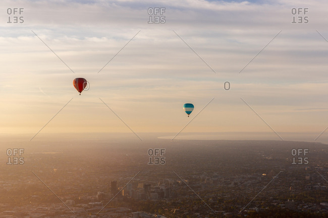 Melbourne, Australia - October 31, 2014: Hot air balloons floating in the morning mist above the city