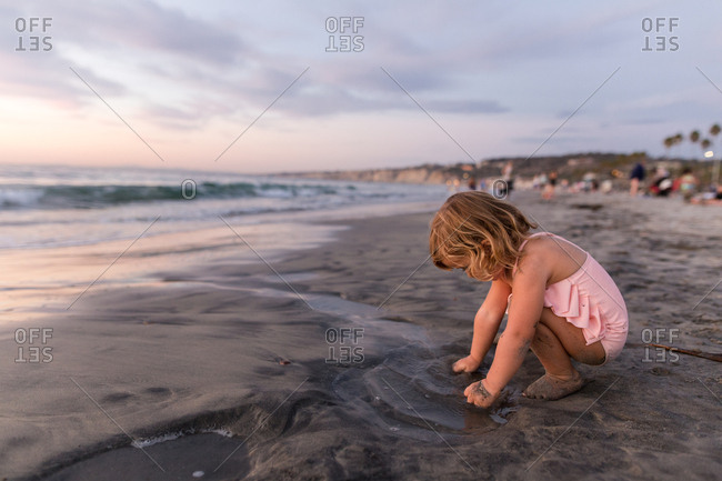Child playing in the sand at the beach