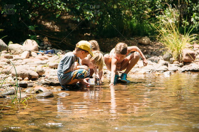 Kids looking at water in river