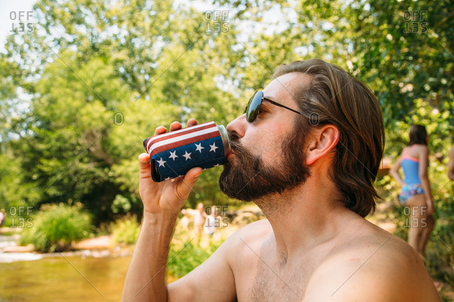 Man drinking from stars and stripes can