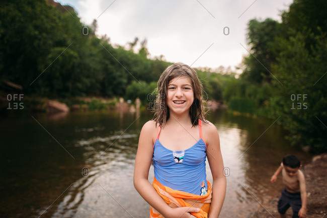 Girl smiling by river's edge