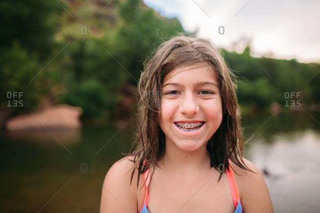 Girl in braces in rural setting