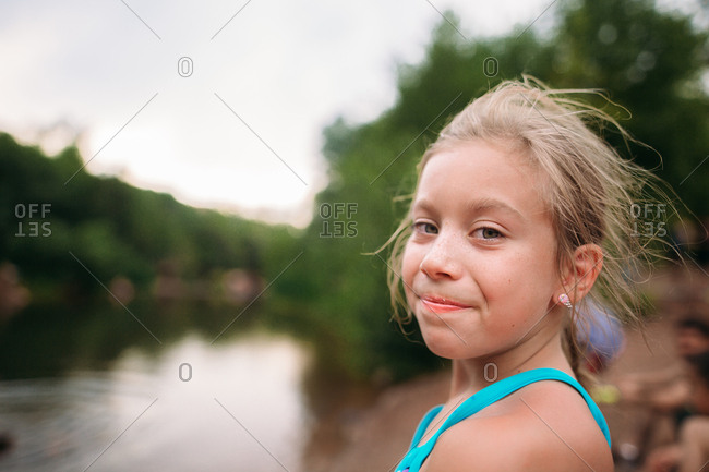 Blonde girl in portrait by river