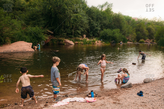 Group of kids playing in river