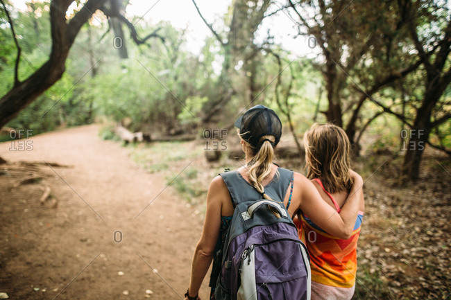 Woman with girl on a forest path