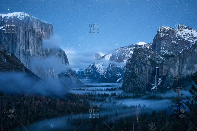 Yosemite Valley at night with clouds