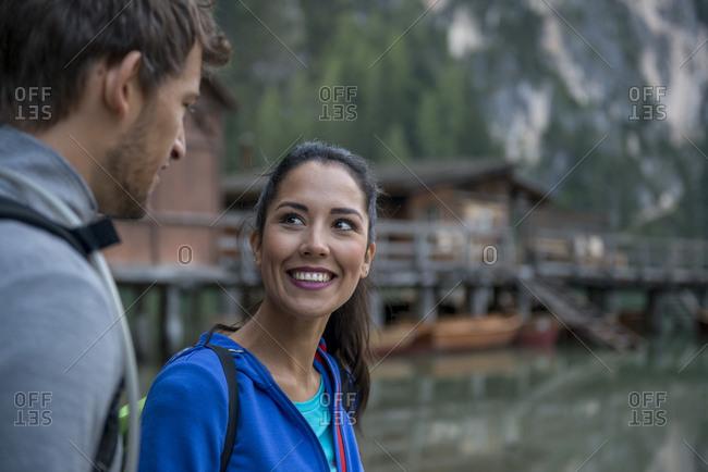 Latin woman looking at a Caucasian man near Braies lake