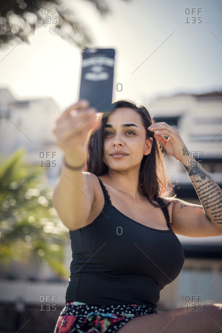 Woman taking selfie outdoors