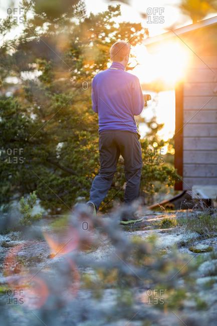 Man in garden at sunset