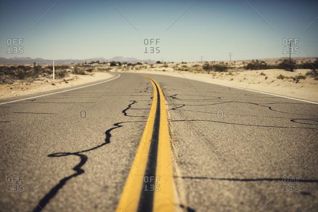 Road marks on empty road in desert