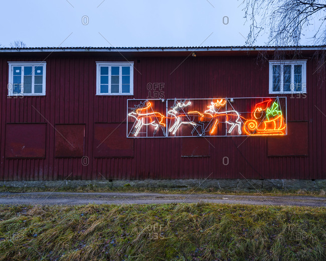 Illuminated Christmas decoration on wooden house