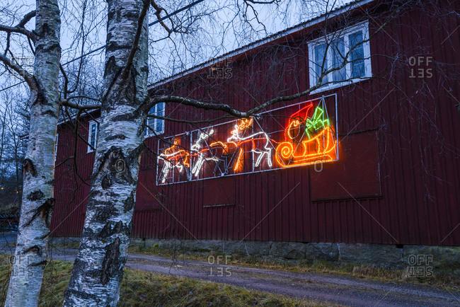 Illuminated Christmas decoration on wooden house
