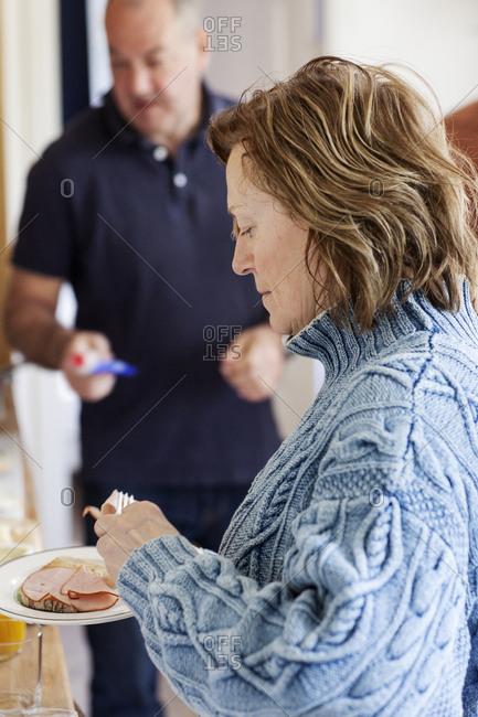 Mature woman making sandwich