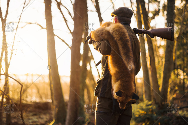 Hunter carrying fox