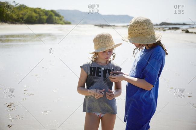 Girls on sandy beach