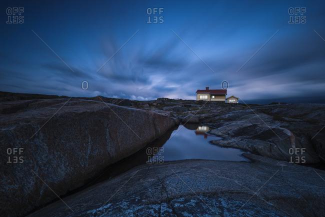 House on rocky coast at twilight