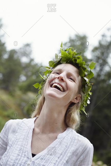 Happy woman wearing leaf wreath